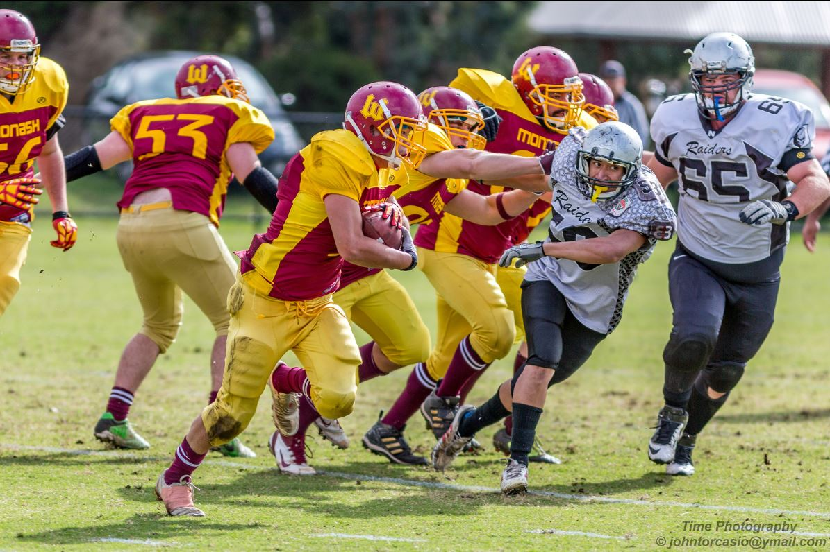Barbarians RB James Pho gets good blocking up front from his OL. (Picture courtesy of John Torcasio)