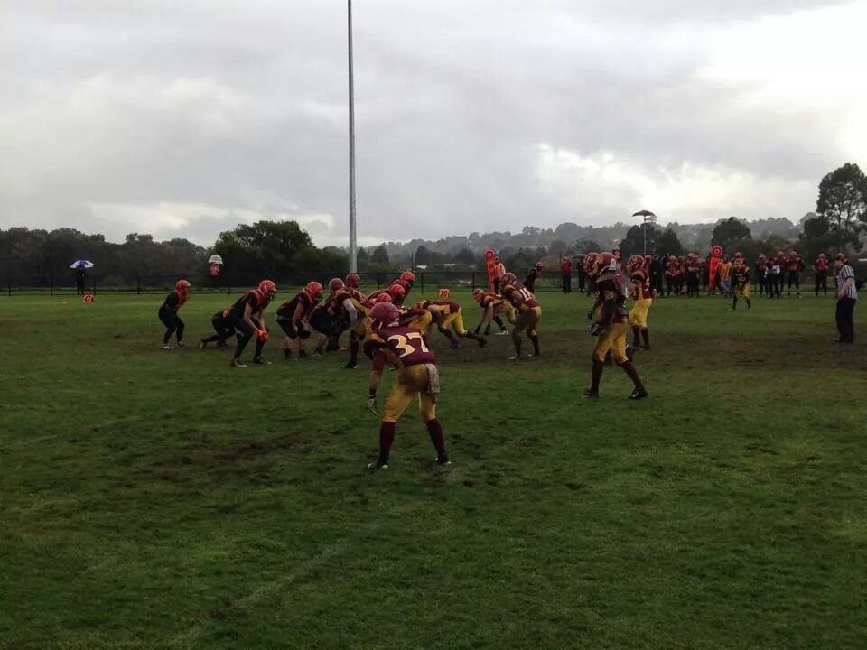 Warriors Defense taking on the Berwick Miners in cold and muddy conditions