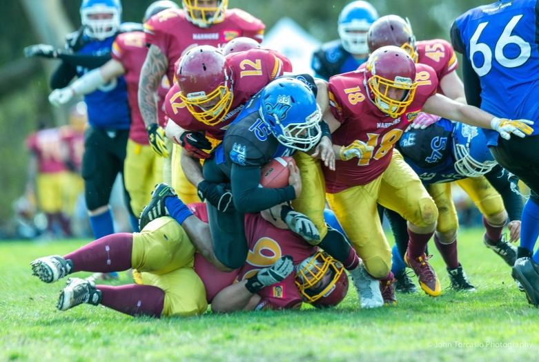Warriors Defense not allowing any running room for the Royals (Photo courtesy of John Torcasio Photography)
