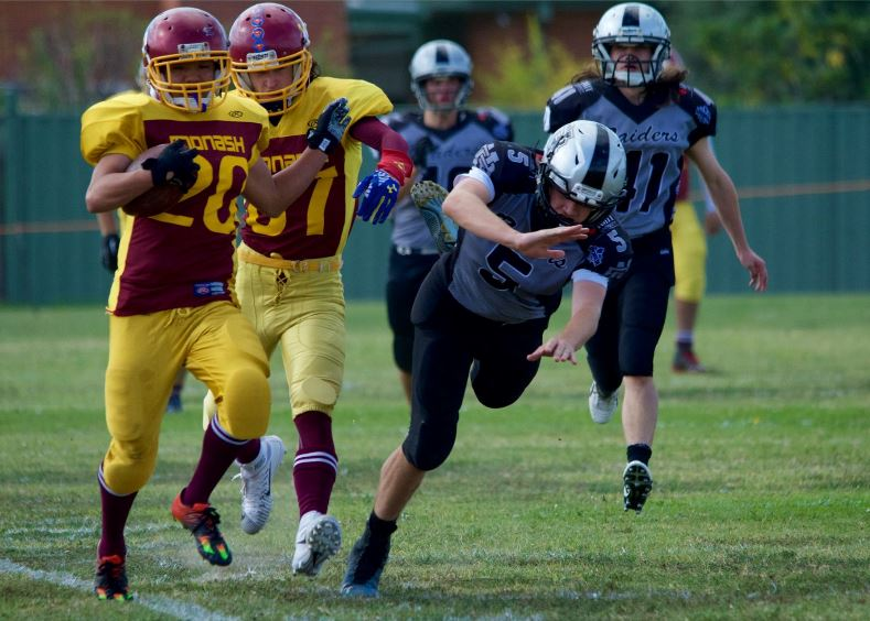 Game MVP RB Brian Huynh runs through the Raiders Defense (Photo courtesy of Bruce Rachon)