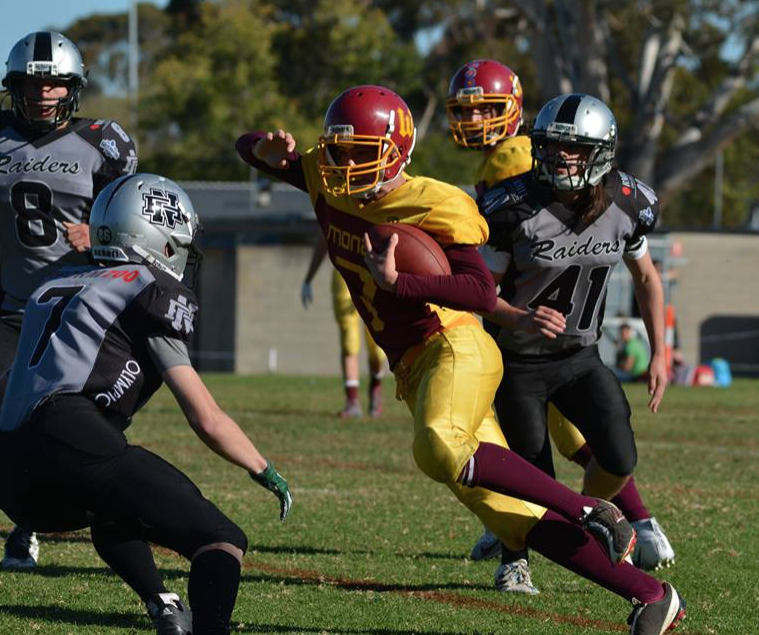 QB Nicholas Whitehead finds scrambles for one of his three rushing touchdowns (Photo courtesy of Bruce Rachon)